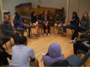 OU youth meeting in a circle